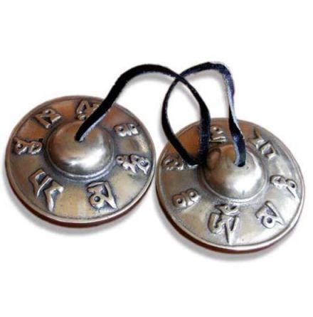 Tingshas, tibetanska klockor med symboler